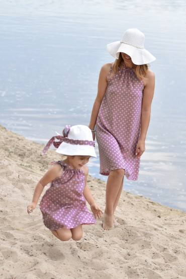A set of trapezoid pink polka dot dresses for mother and daughter