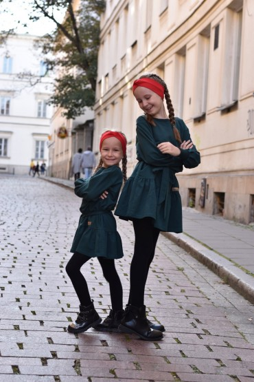 A set of the same dresses with a frill for sisters in bottle green